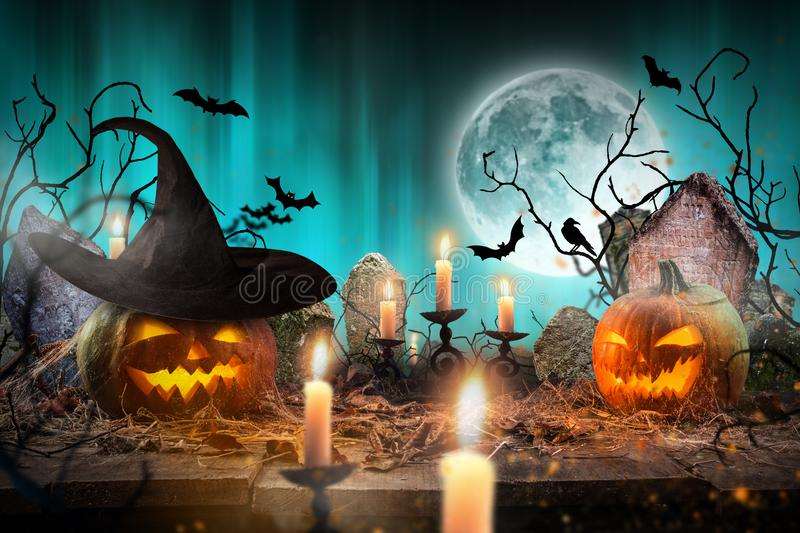 Spooky Halloween background. Spooky Halloween pumpkins on wooden planks with spooky background stock images