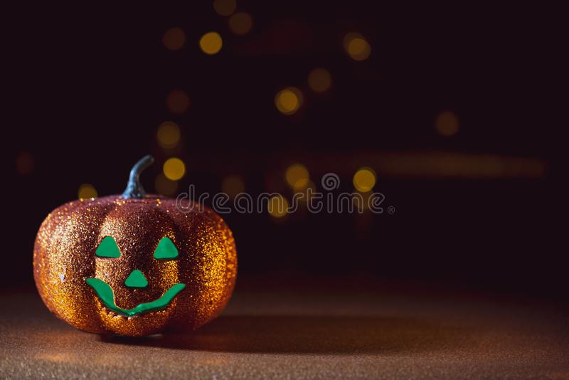 Spooky halloween Jack O Lantern background. A Spooky halloween dark background with a Jack O Lantern and green eyes stock photo