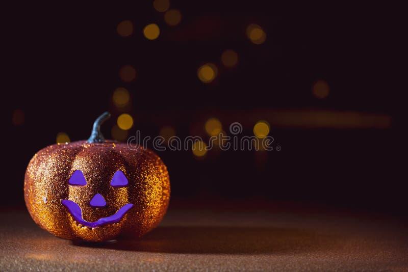 Spooky halloween Jack O Lantern background. A Spooky halloween dark background with a Jack O Lantern and purple eyes royalty free stock photo