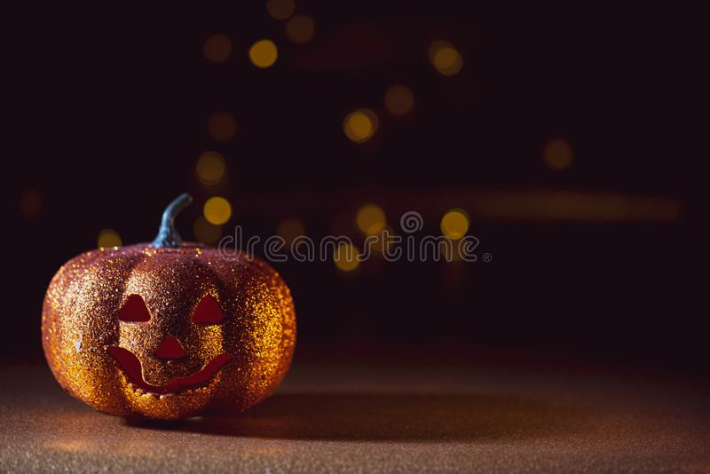 Spooky halloween Jack O Lantern background. A Spooky halloween dark background with a Jack O Lantern and red eyes royalty free stock photography