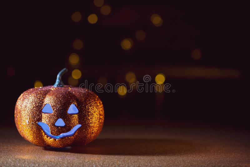 Spooky halloween Jack O Lantern background. A Spooky halloween dark background with a Jack O Lantern and blue eyes royalty free stock photography