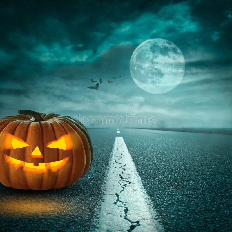 Free Spooky Halloween Pumpkin On Asphalt Road At Moonlight Stock Photography - 99495702