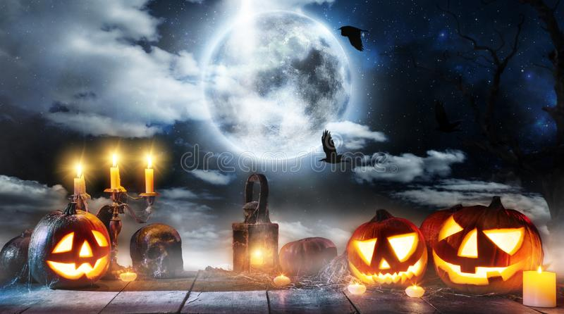 Spooky halloween pumpkin placed on wooden planks royalty free stock image
