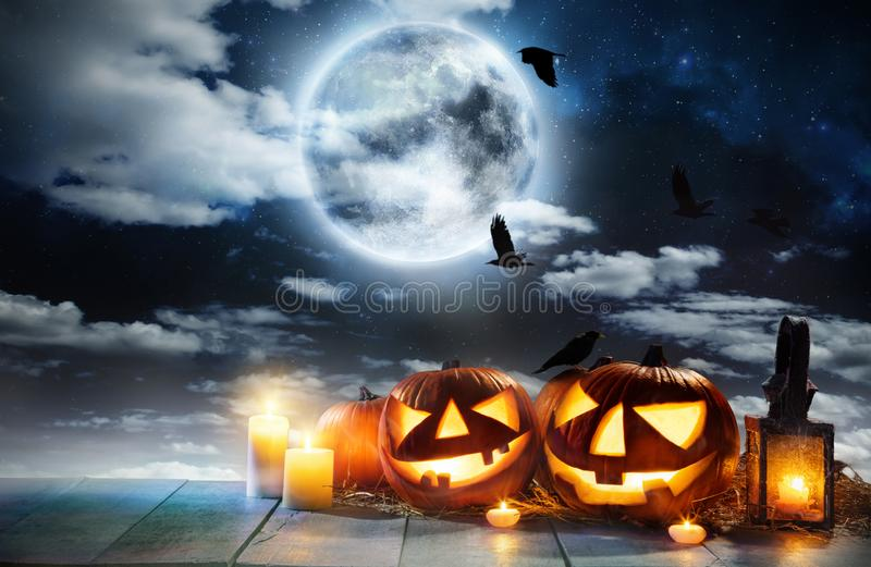Spooky halloween pumpkin placed on wooden planks stock image