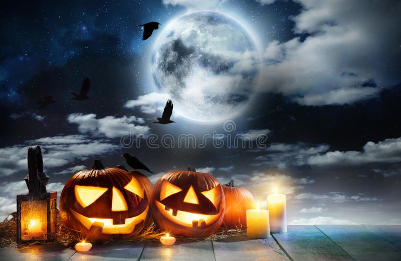 Spooky halloween pumpkin placed on wooden planks royalty free stock photography