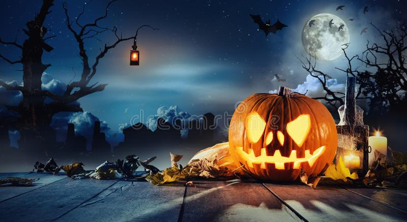 Spooky halloween pumpkin on wooden planks. With dark horror background. Celebration theme, copyspace for text stock photo