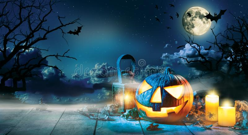 Spooky halloween pumpkin on wooden planks. With dark horror background. Celebration theme, copyspace for text royalty free stock photography