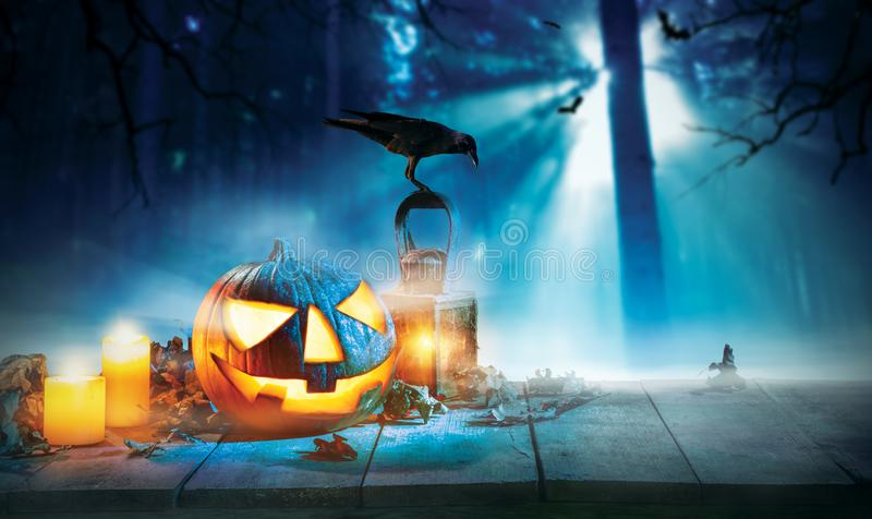 Spooky halloween pumpkin on wooden planks. With dark horror background. Celebration theme, copyspace for text royalty free stock images