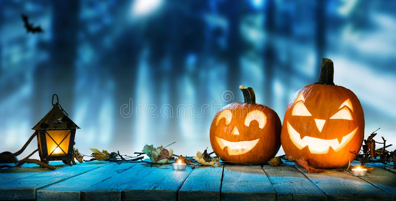 Spooky halloween pumpkins in forest royalty free stock image