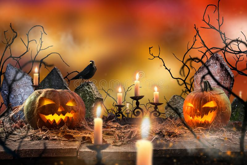 Spooky Halloween background. Spooky Halloween pumpkins on wooden planks with spooky background royalty free stock photography