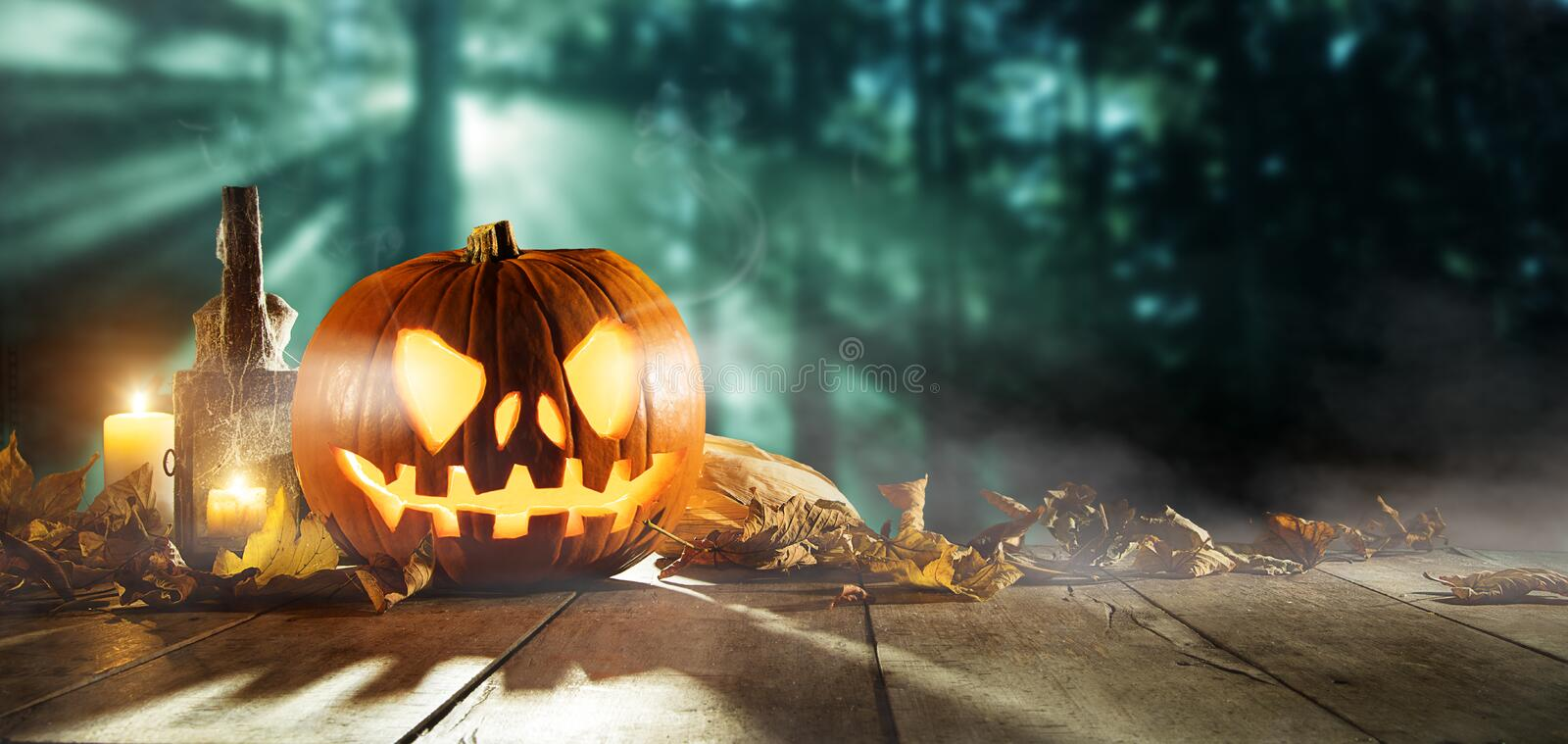 Spooky halloween pumpkins on wooden planks. With dark horror background. Celebration theme, copyspace for text royalty free stock photo