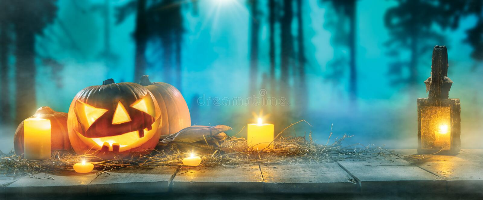 Spooky halloween pumpkins on wooden planks. With dark horror background. Celebration theme, copyspace for text stock photos