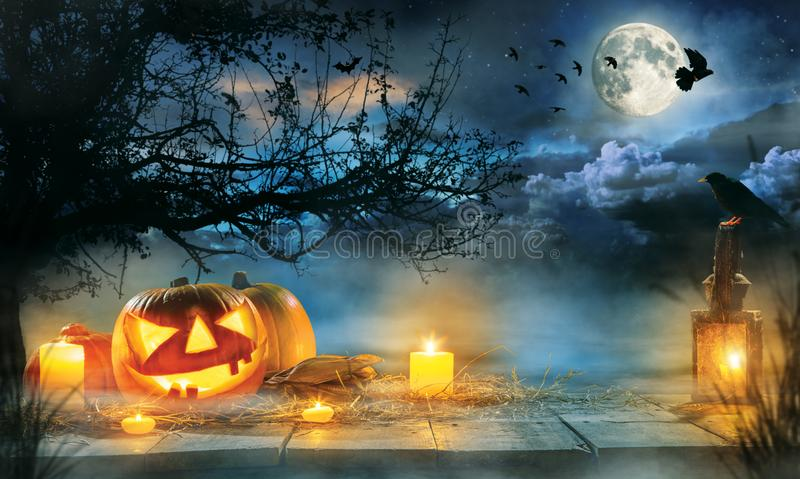Spooky halloween pumpkins on wooden planks stock photos