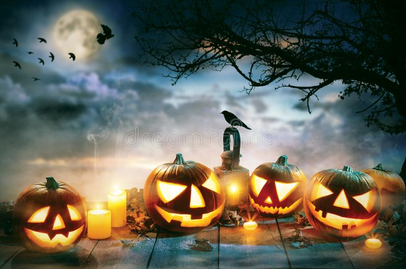 Spooky halloween pumpkins on wooden planks. With dark horror background. Celebration theme, copyspace for text stock photography