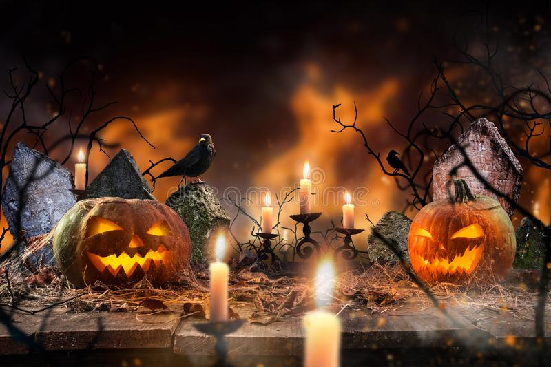 Spooky Halloween background. Spooky Halloween pumpkins on wooden planks with spooky background royalty free stock images