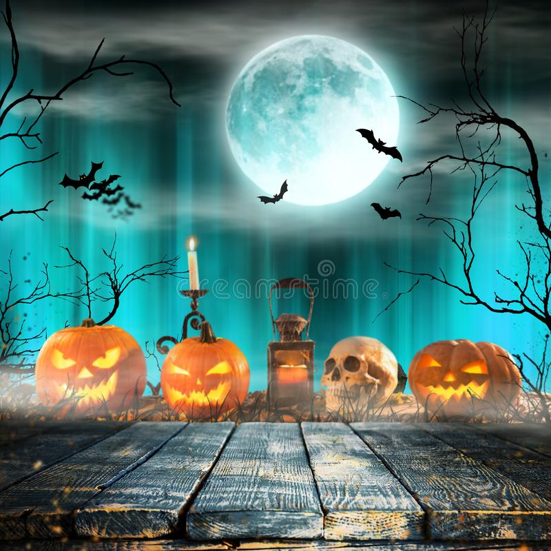 Spooky Halloween background. Spooky Halloween pumpkins on wooden planks with spooky background stock photography