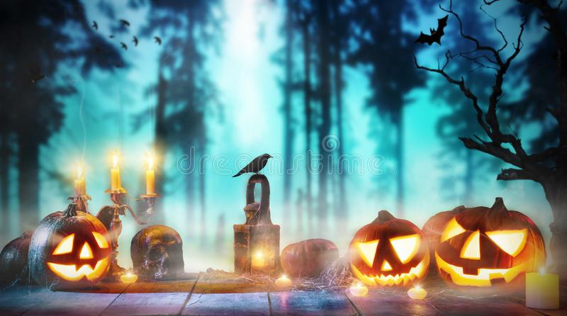 Spooky halloween pumpkins on wooden planks. With dark horror background. Celebration theme, copyspace for text stock images