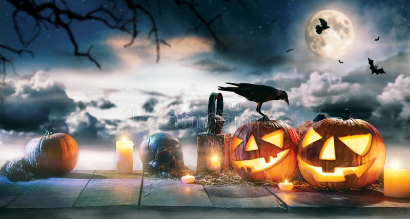 Spooky halloween pumpkins on wooden planks. With dark horror background. Celebration theme, copyspace for text royalty free stock image