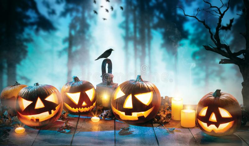 Spooky halloween pumpkins on wooden planks. With dark horror background. Celebration theme, copyspace for text stock image