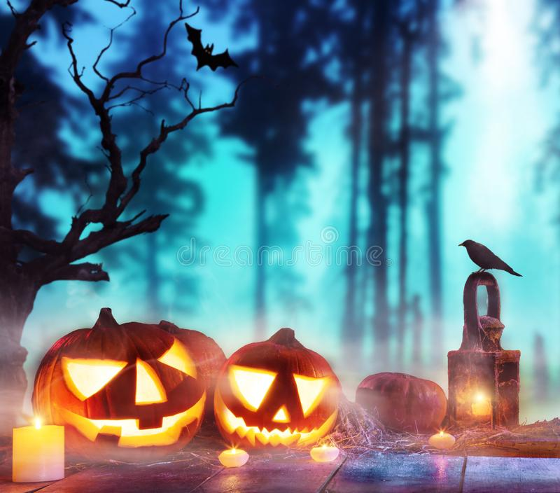 Spooky halloween pumpkins on wooden planks. With dark horror background. Celebration theme, copyspace for text royalty free stock photography