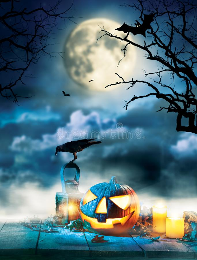 Spooky halloween pumpkins on wooden planks. With dark horror background. Celebration theme, copyspace for text. Very high resolution image stock photography