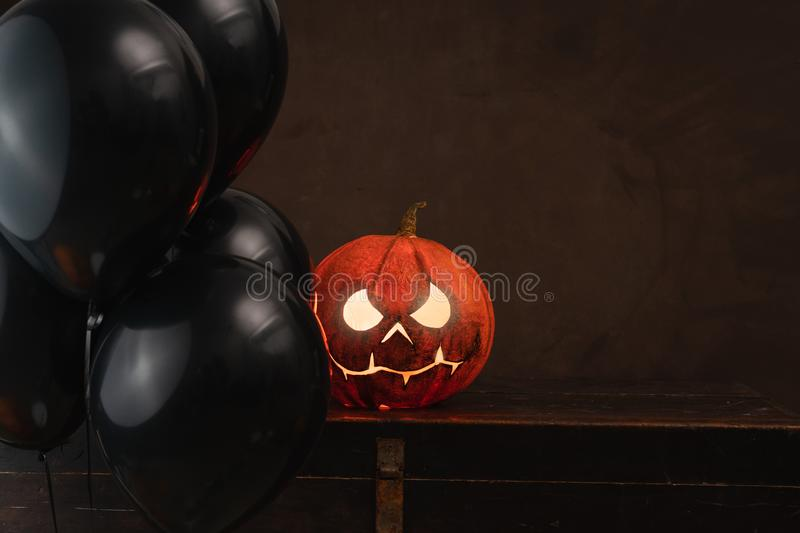 Spooky Halloween pumpkins on wooden planks with vintage background. royalty free stock image