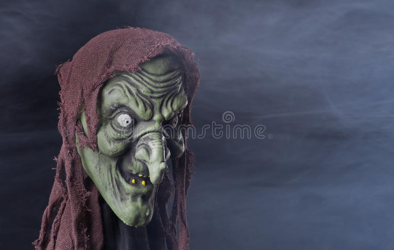 Spooky Halloween Witch. Prop on a smoky background royalty free stock images