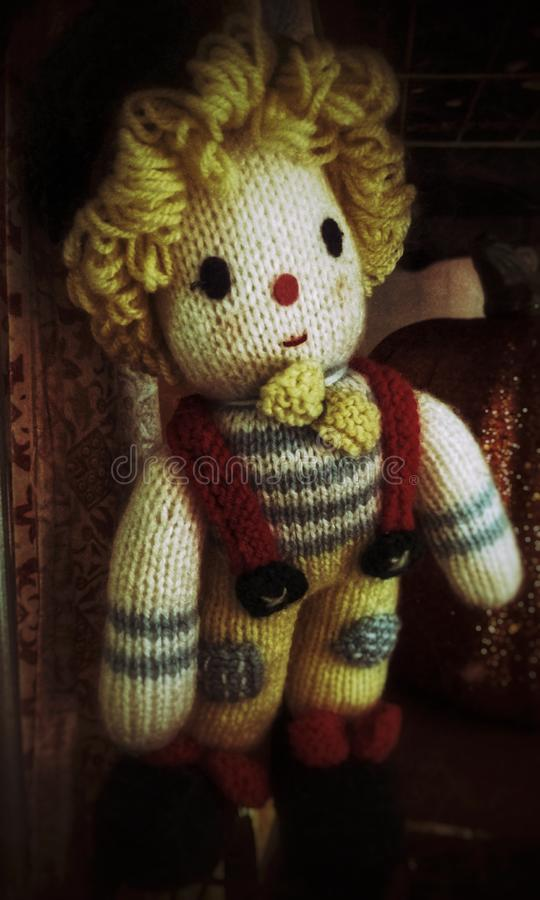 Spooky knitted clown doll handmade of yarn royalty free stock photo