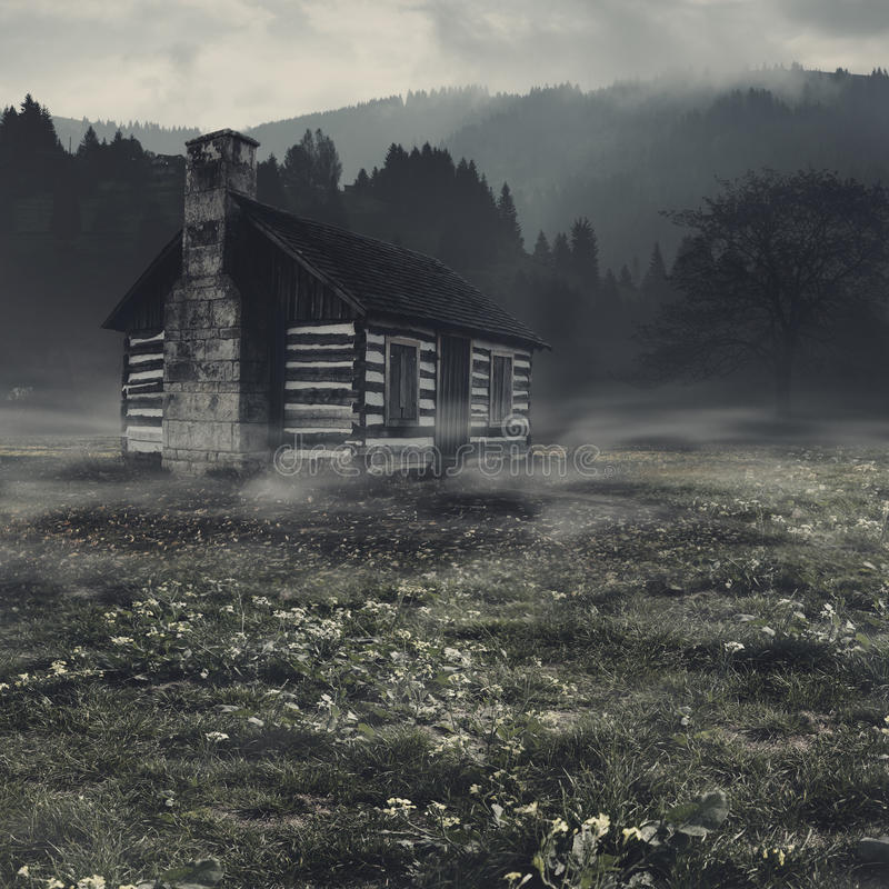 Spooky landscape. With alone haunted house against dark mountain stock photos
