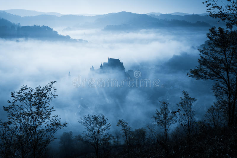 Spooky misty rainy forest. Located in Transylvania, Romania, Halloween holiday celebration background concept stock photos