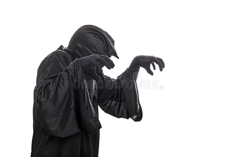 Spooky monster in hooded cloak. Isolated on white background royalty free stock photos