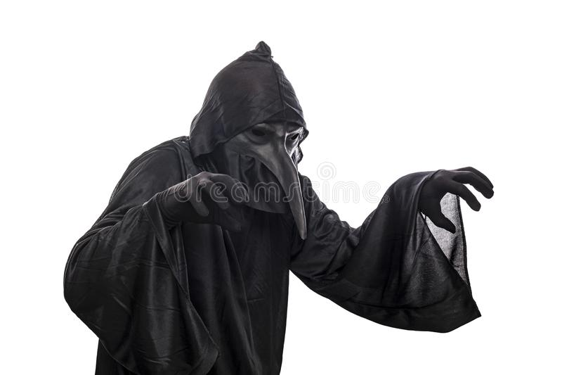 Spooky monster in hooded cloak. Isolated on white background royalty free stock image