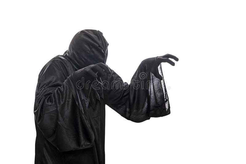 Spooky monster in hooded cloak. Isolated on white background royalty free stock photo