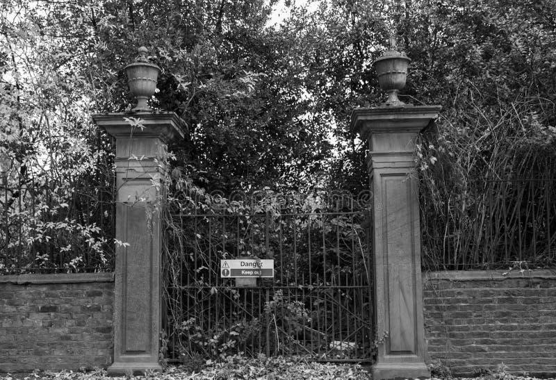 Spooky padlocked Halloween gates royalty free stock image