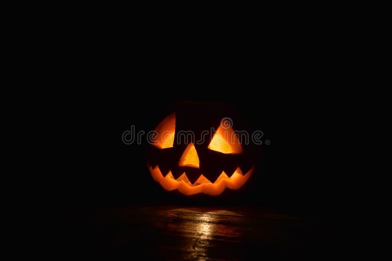 Spooky pumpkin Halloween with fire light on black background. Spooky fire pumpkin Halloween with fire light on black background stock image