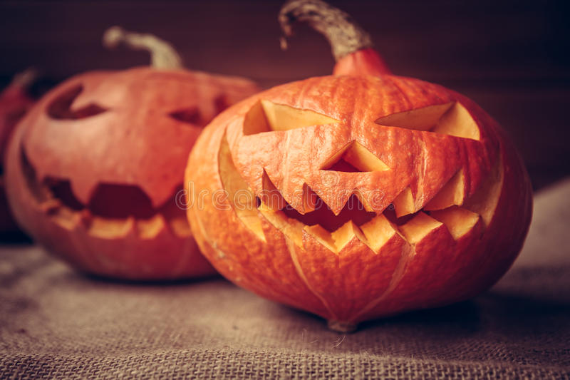 Spooky pumpkins for Halloween party on dark rustic background royalty free stock photography