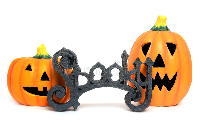 Spooky Pumpkins. Two spooky pumpkins for halloween isolated on white background stock photo