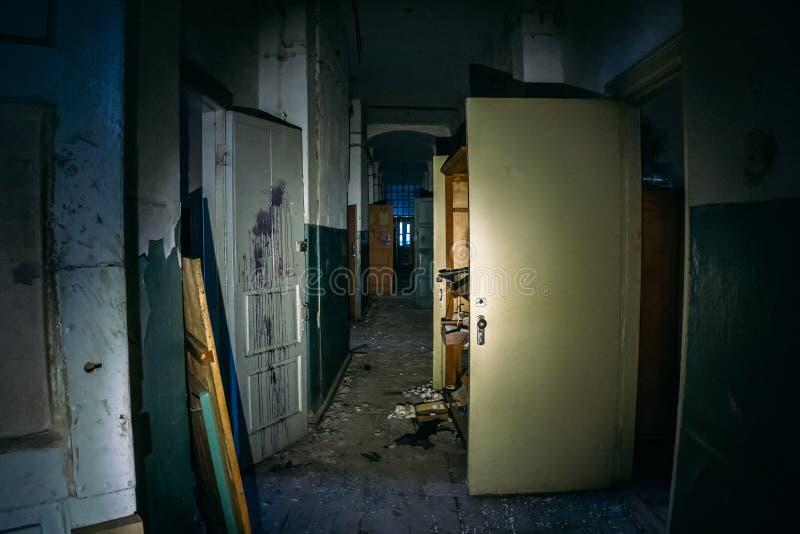Spooky terrible dark corridor in old abandoned ruined hospital stock image