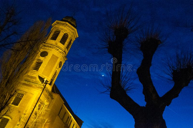 Spooky Town at night. A False color night shot of a Flemish Monestary in the Town of Drongen royalty free stock image