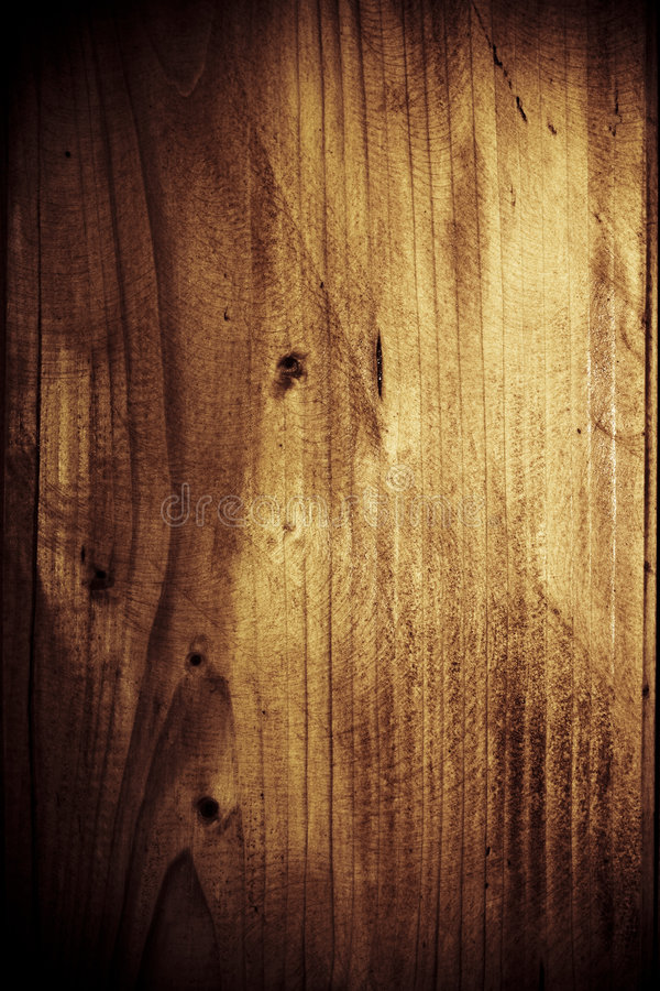 Spooky wooden background. Dark spooky wooden background with vignette effect and light spot in center part stock images