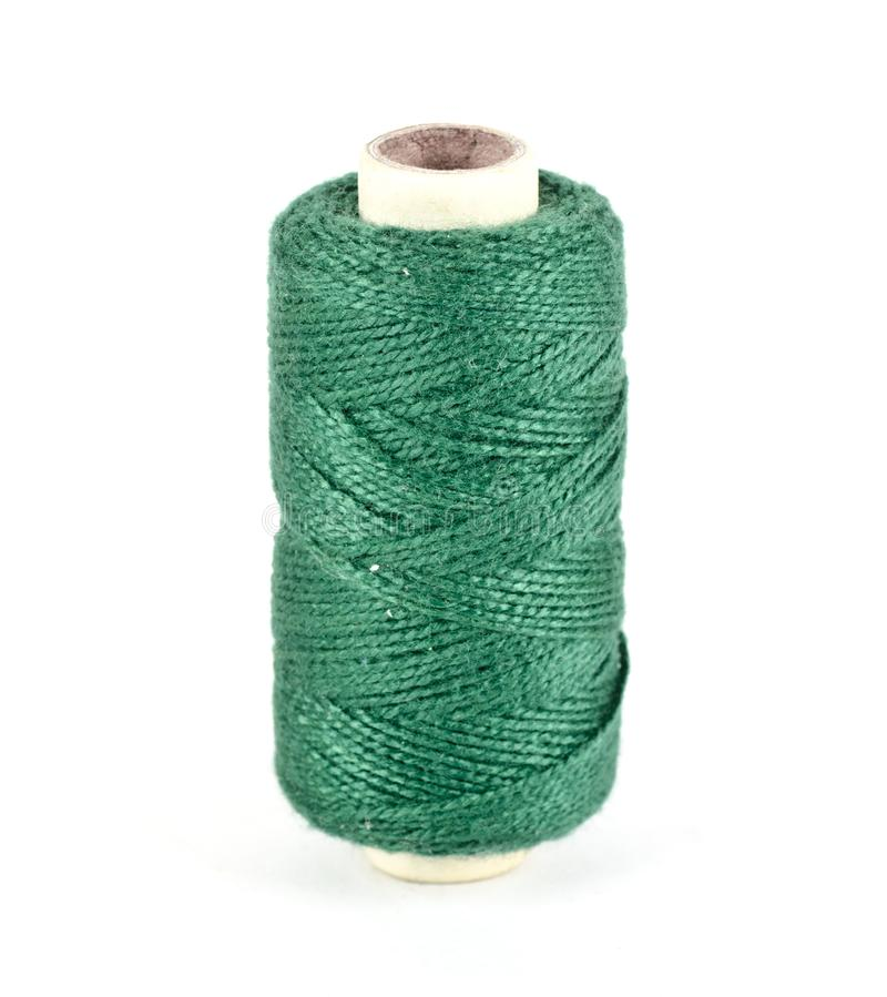 A spool of green sewing thread royalty free stock image