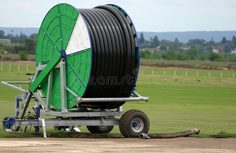 Spool of Irrigation Pipe stock photos