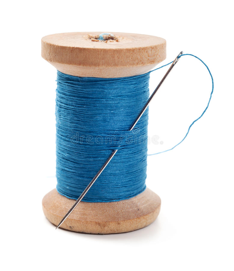 Spool of thread. With needle isolated on white royalty free stock images