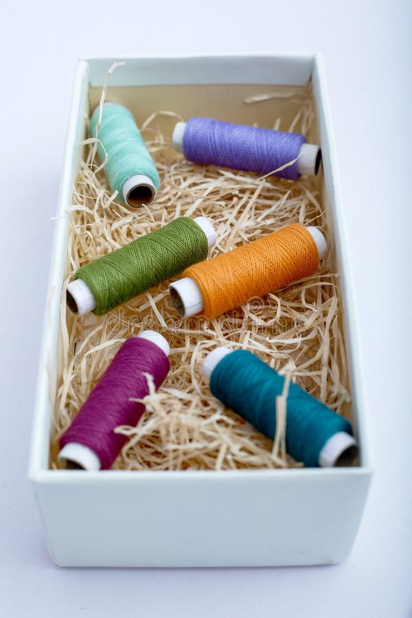 Spool of thread in the box royalty free stock image