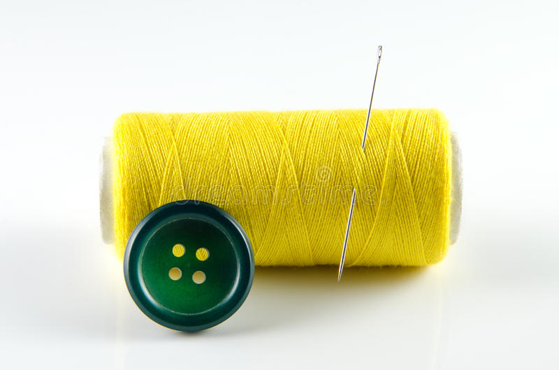Download Spool of thread and button stock image. Image of color - 26428049