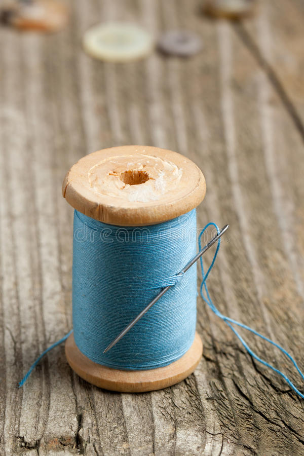 Download Spool of thread and needle stock image. Image of instrument - 19466761