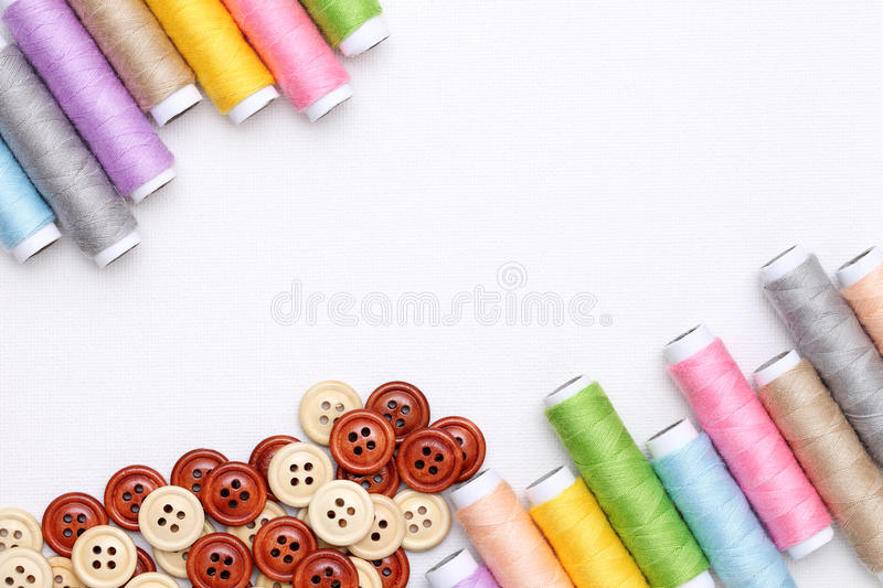 Spool of threads and buttons royalty free stock image