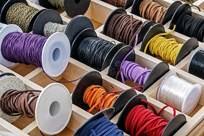 Spools With Chains And Colored Ribbons 1 Royalty Free Stock Photos