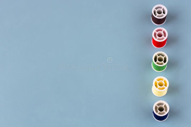 Spools of colored thread stock photos