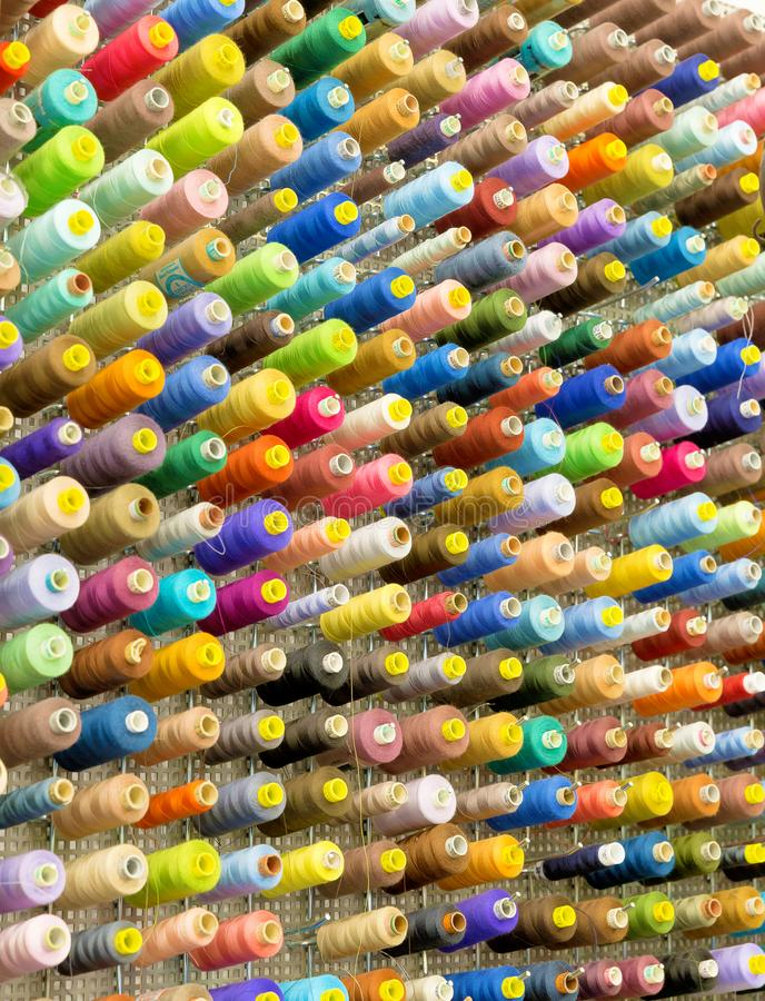 Spools with colorful sewing threads royalty free stock photos